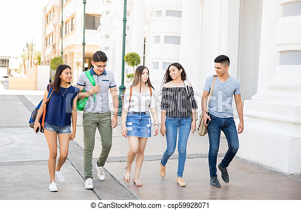 Group Of Teens Going To School Full Length Portrait Of Teenagers