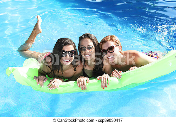 Group of three happy and beautiful young girl friends - Swimming pool girl christmas vacation ...
