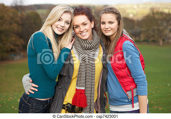 Group Of Three Teenage Female Friends In Autumn Landscape - csp7423001