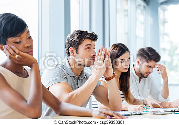 Group of tired bored people on business meeting in office - csp39338381