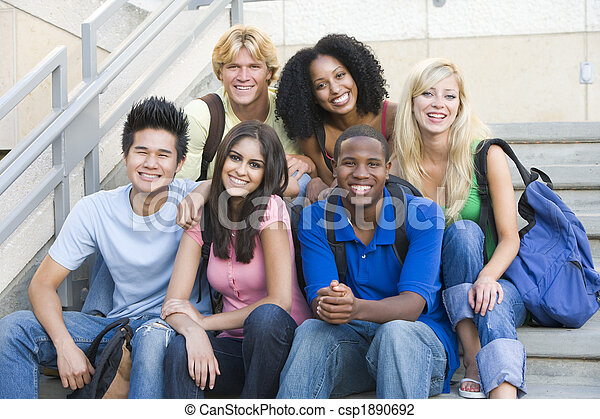 Group of university students sitting on steps - csp1890692