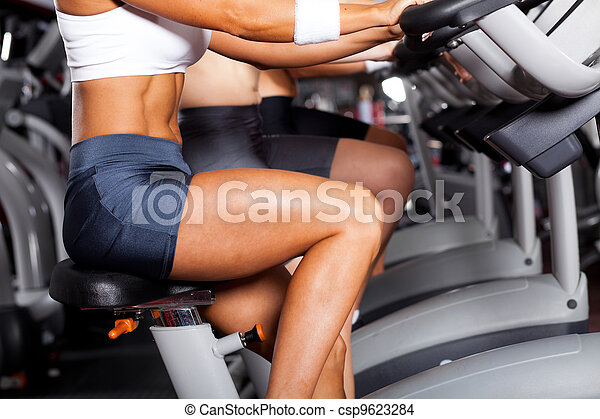 group of women cycling in gym - csp9623284
