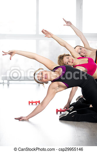 Group of women doing fitness training in class - csp29955146
