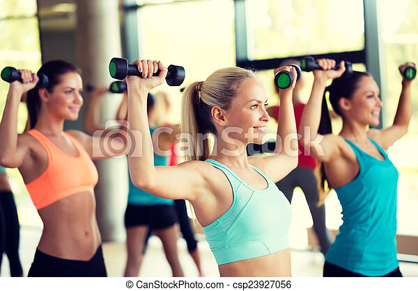 group of women with dumbbells in gym - csp23927056