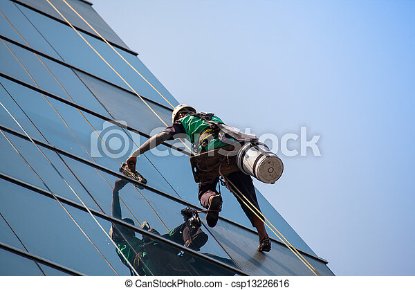 group of workers cleaning windows service on high rise building - csp13226616