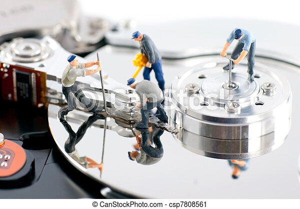 Group of workers repair hard drive - csp7808561