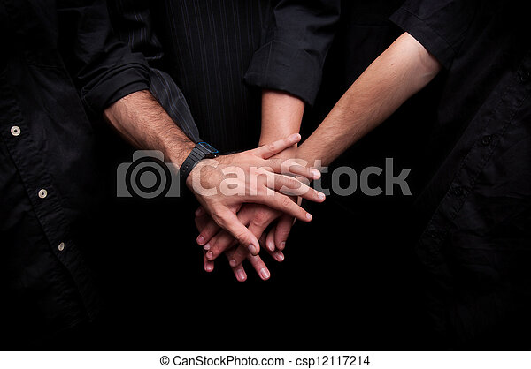 Group of young adults making a pile of hands - csp12117214