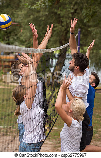 group of young friends playing Beach volleyball - csp62775967