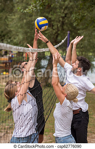 group of young friends playing Beach volleyball - csp62776090
