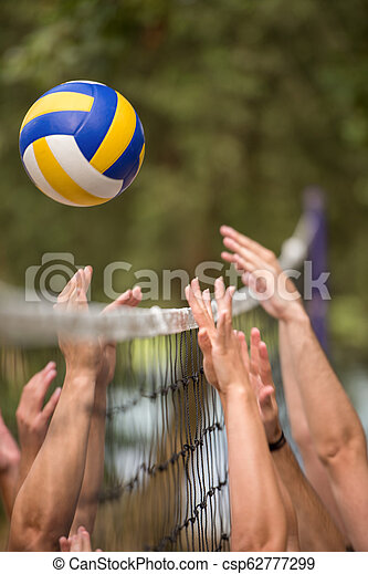 group of young friends playing Beach volleyball - csp62777299