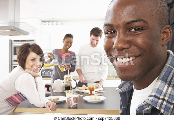 Group Of Young Friends Preparing Breakfast In Modern Kitchen - csp7425868