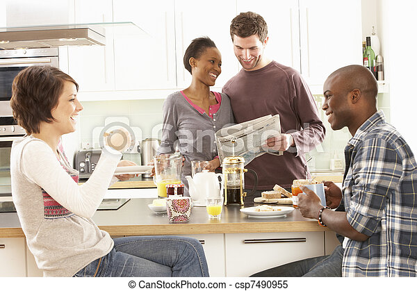 Group Of Young Friends Preparing Breakfast In Modern Kitchen - csp7490955