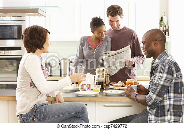 Group Of Young Friends Preparing Breakfast In Modern Kitchen - csp7429772