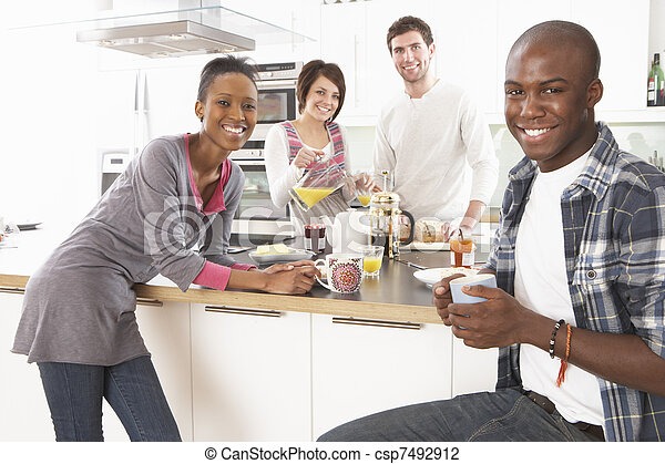 Group Of Young Friends Preparing Breakfast In Modern Kitchen - csp7492912