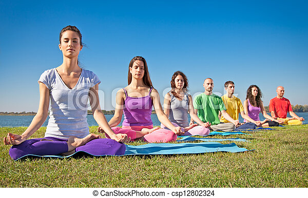 Group of young people have meditation on yoga class.  - csp12802324