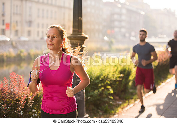 group of young people jogging in the city - csp53403346