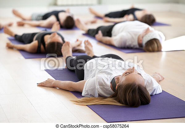 group of young sporty people in dead body pose group of
