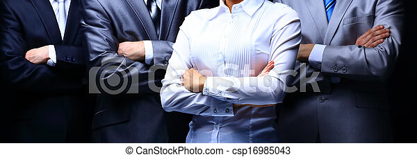 Group portrait of a professional business team on dark background - csp16985043