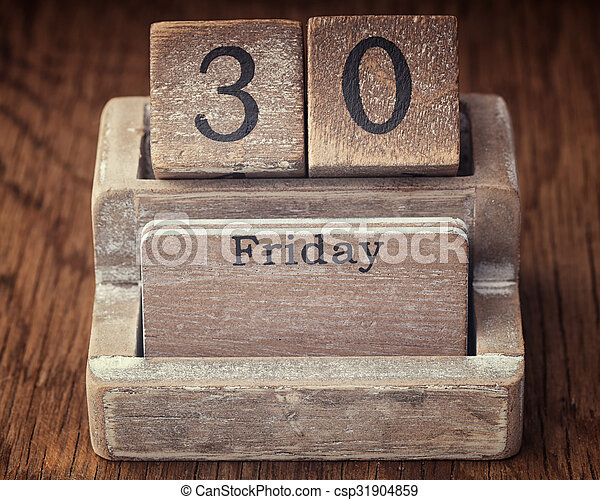 Grunge calendar showing Friday the thirtieth on wood background - csp31904859