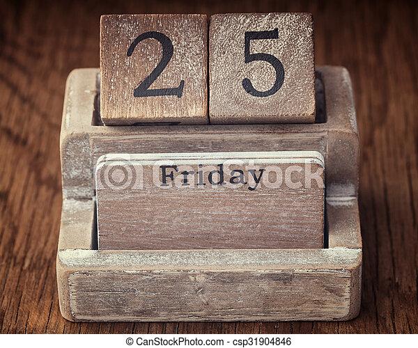 Grunge calendar showing Friday the twenty fifth on wood background - csp31904846