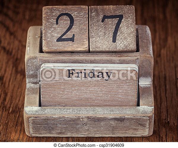 Grunge calendar showing Friday the twenty seventh on wood background - csp31904609