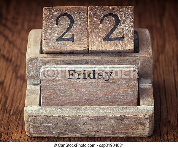 Grunge calendar showing Friday the twenty second on wood background - csp31904831