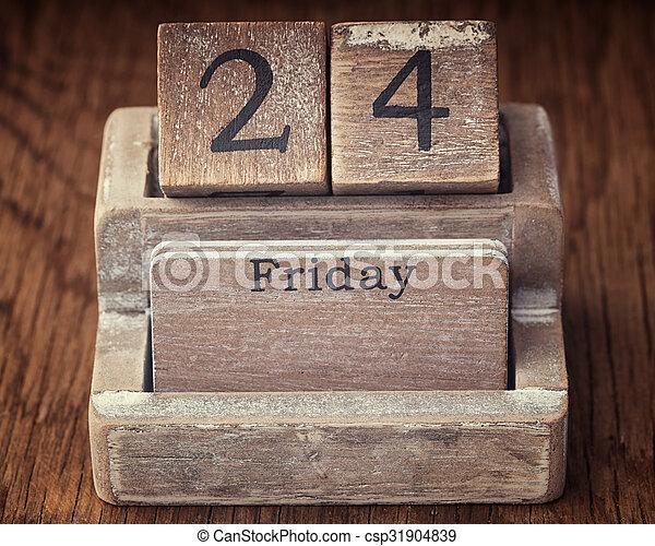 Grunge calendar showing Friday the twenty fourth on wood background - csp31904839