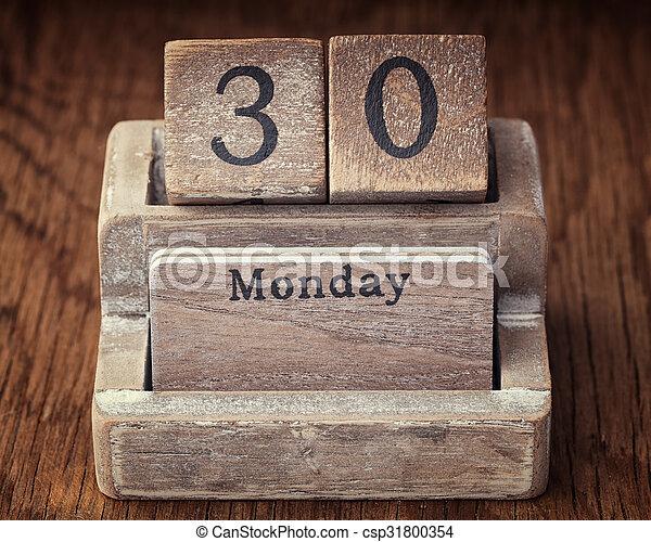 Grunge calendar showing Monday the thirtieth - csp31800354