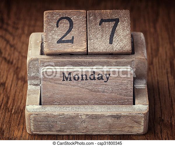 Grunge calendar showing Monday the twenty seventh - csp31800345