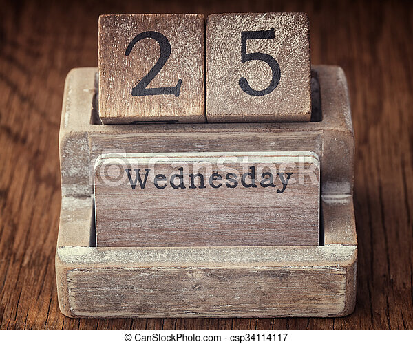 Grunge calendar showing Wednesday the twenty fifth on wood background - csp34114117