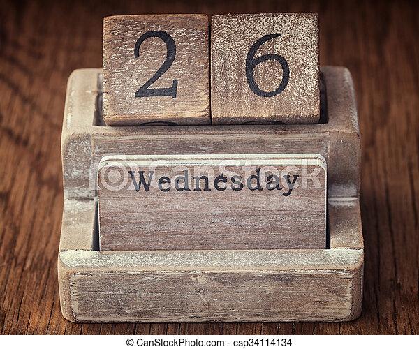 Grunge calendar showing Wednesday the twenty sixth on wood background - csp34114134