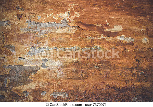Grunge old wall with orange paint - csp47370971