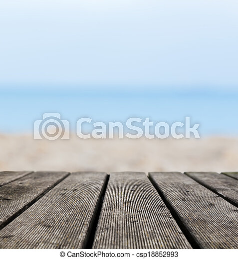 Grunge rustic real wood boards on the beach shore, ocean background - csp18852993