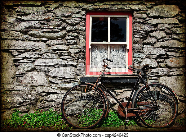 grunge texture rural irish cottage with bicycle - csp4246423