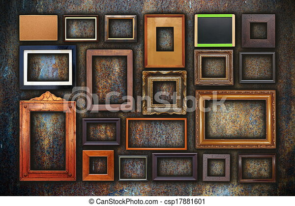 Grunge wall full of old frames. Grunge wall full of old wooden ...