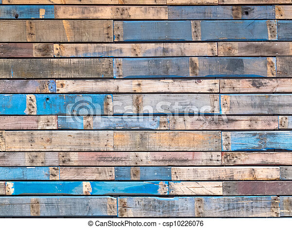 Grungy blue painted wood planks of exterior siding - csp10226076