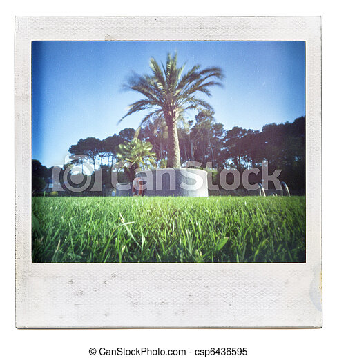 Grungy grainy and dusty instant film frame with saturated summer image, isolated on white background - csp6436595