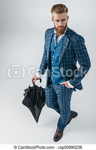 Hombre guapo de traje con paraguas - csp50990236