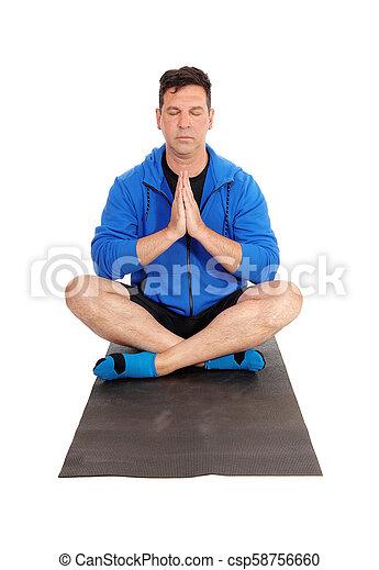 Un Hombre Apuesto Sentado En El Suelo Haciendo Yoga Un Hombre Meditando Con Una Chaqueta Azul Sentado En El Suelo En Una Canstock #nosotros_los_guapos | 482.6k people have watched this. un hombre apuesto sentado en el suelo