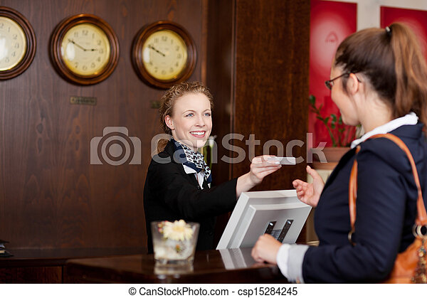Guest at a hotel requesting a card - csp15284245