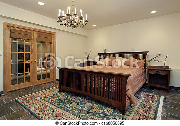 Guest bedroom with french doors - csp8050895