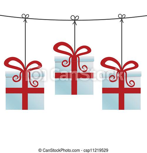 Cajas de regalos rojas colgando de una cuerda - csp11219529