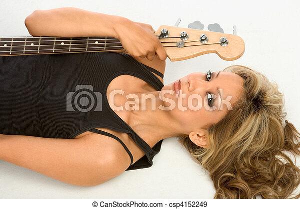 Guitar girl On the floor - csp4152249