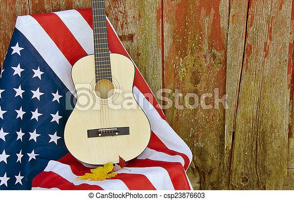 guitar on American flag - csp23876603