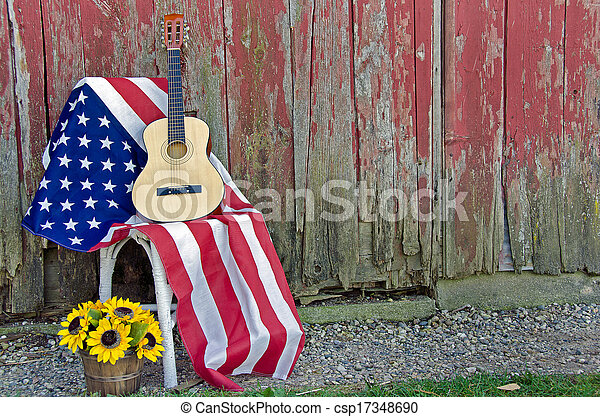 guitar with flag and sunflowers - csp17348690