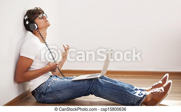 Hipster tocando la guitarra - csp15800636