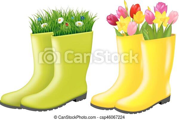 Gumboots con hierba y flores - csp46067224