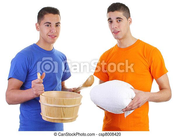 Guy holding sauna tools - csp8008420