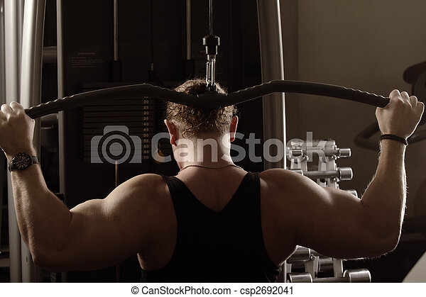 Guy training back muscles - csp2692041