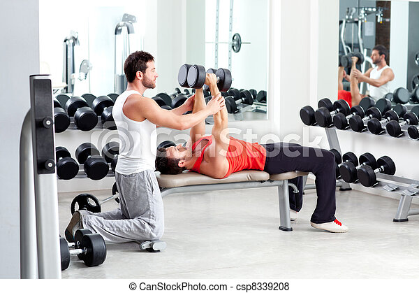 gym personal trainer man with weight training - csp8339208